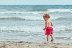 Little cute happy girl bathes in sea,  Italy, outdoor Royalty Free Stock Photos