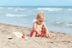 Little cute happy girl bathes in sea,  Italy, outdoor Stock Photography
