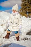 Little cute happy girl having fun in the snow on a Stock Image
