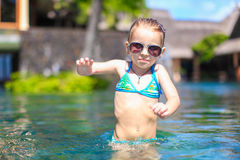 Little cute happy girl in swimming pool during Royalty Free Stock Photo