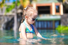 Little cute happy girl in swimming pool during Royalty Free Stock Image