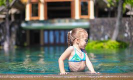 Little cute happy girl in swimming pool during Royalty Free Stock Photography