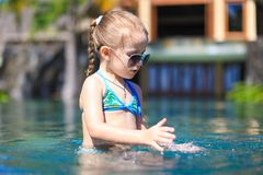 Little cute happy girl in swimming pool during Stock Image
