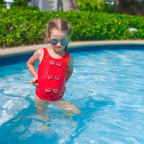 Little cute happy girl swims in the swimming pool Stock Photography