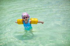 Little cute happy girl at swimsuit has fun in the Royalty Free Stock Images