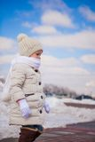 Little cute happy girl is walking in the snow on a Royalty Free Stock Photos