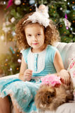 Little cute сhristmas girl  with bunny Stock Images