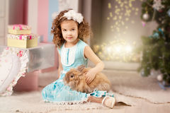 Little cute сhristmas girl  with bunny Stock Photography