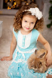 Little cute сhristmas girl  with bunny Stock Image