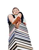 A little cute kid and  books Stock Photos