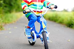Little cute kid boy on bicycle on summer or autmn day. Healthy happy child having fun with cycling on bike. Stock Photography