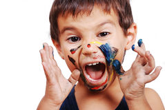 Little cute kid with colors on his face Royalty Free Stock Photos