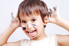 Little cute kid with colors on his face royalty free stock images