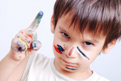Little cute kid with colors on his face Royalty Free Stock Photography