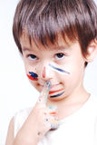 Little cute kid with colors on his face Stock Photos