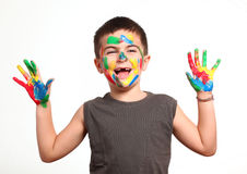 Little cute kid with colors on his face stock image