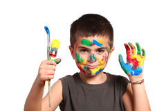 Little cute kid with colors on his face stock photo