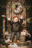 Little cute kid happy cheers christmas in vintage style Stock Images