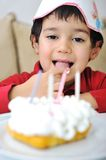 Little cute kid and his birthday Stock Photo