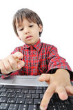A little cute kid with a laptop Stock Images