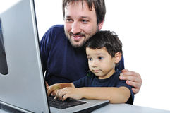 A little cute kid with a laptop isolated Royalty Free Stock Photography