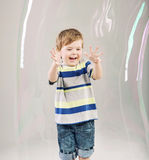 Little cute kid playing a soap bubbles Stock Image