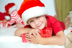 Little cute kid in santas red hat Royalty Free Stock Image