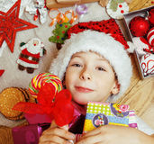 Little cute kid in santas red hat with handmade Stock Photo