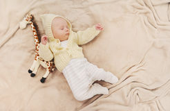 Little cute newborn baby boy sleeping with giraffe toy. Sleeping cute newborn baby, maternity concept, soft image of beautiful family royalty free stock photo