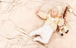Little cute newborn baby boy sleeping with giraffe toy. Sleeping cute newborn baby, maternity concept, soft image of beautiful family royalty free stock photos