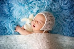 Little cute newborn baby boy, sleeping wrapped in white wrap Royalty Free Stock Photo