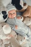 Newborn baby laying with five teddy bears on blanket Royalty Free Stock Photos
