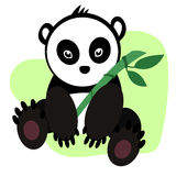 Little cute panda. Little cute black and white panda sitting and holding a green bamboo stalk Royalty Free Stock Photo