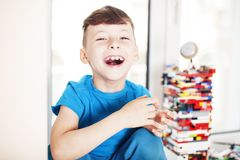 Little cute preschooler boy playing constructor toys at home happy smiling, lifestyle children concept close up stock images