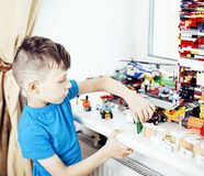 Little cute preschooler boy playing lego toys at home happy smil Royalty Free Stock Images