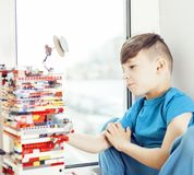 Little cute preschooler boy playing lego toys at home happy smil Royalty Free Stock Photos