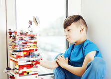 Little cute preschooler boy playing lego toys at home happy smil Stock Photography