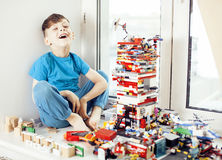Little cute preschooler boy playing lego toys at home happy smiling, lifestyle children concept Royalty Free Stock Images