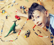 Little cute preschooler boy playing lego toys at home happy smiling, lifestyle children concept Royalty Free Stock Photography