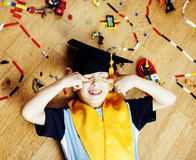 Little cute preschooler boy among toys lego at home education in Royalty Free Stock Image