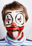 Little cute real boy with facepaint like clown, pantomimic expre Royalty Free Stock Photo