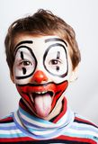 Little cute real boy with facepaint like clown, pantomimic expre Royalty Free Stock Images