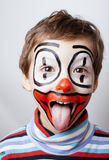 Little cute real boy with facepaint like clown Stock Photography