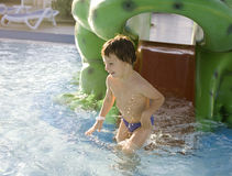 Little cute real boy in swimming pool close up smiling Royalty Free Stock Photography