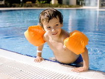 Little cute real boy in swimming pool close up smiling Royalty Free Stock Image