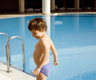 Little cute real boy in swimming pool close up smiling Stock Images