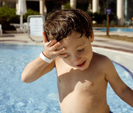Little cute real boy in swimming pool close up smiling Stock Photography