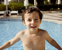 Little cute real boy in swimming pool close up smiling Stock Photos