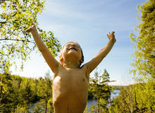 Little cute real boy among tree hight, outdoor lifestyle people Stock Images