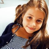 Little cute girl at home smiling. Little cute real girl at home interior smiling stock images